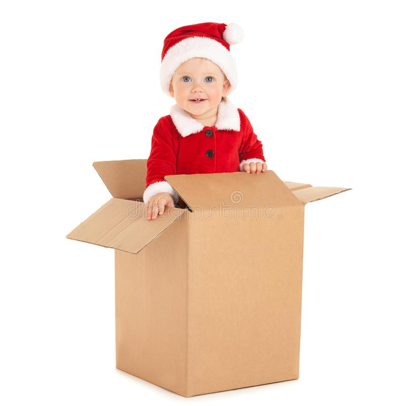 Cute baby-santa with beautiful blue eyes inside the box isolated on white. Christmas, xmas, winter concept. Happy childhood. Santa royalty free stock image