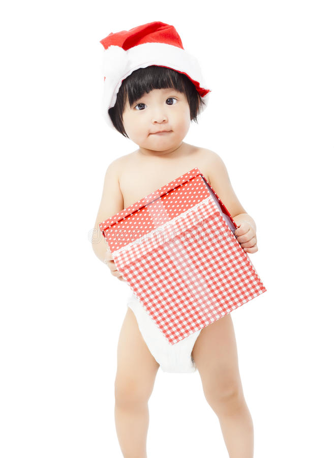 Cute baby in Santa cap holding a gift box stock photography