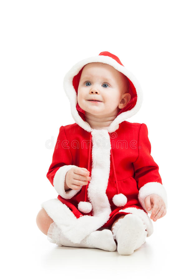 Cute baby in Santa Claus clothes. Cute baby girl in Santa Claus clothes stock photo