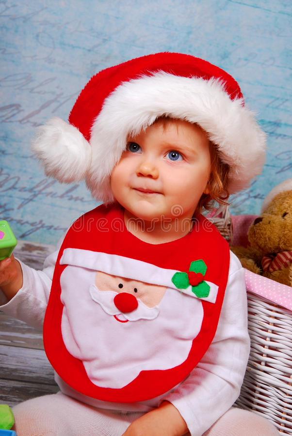 Download Cute Baby In Santa Hat Playing With Toys Stock Photo - Image: 28180944