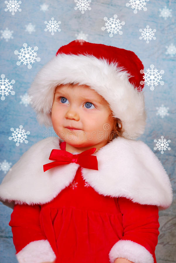 Download Cute Baby In Santa Hat With Snow Flakes Stock Image - Image: 28180863