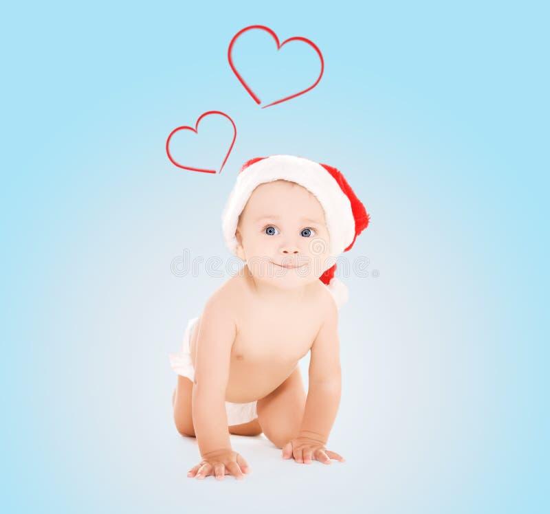 Cute baby in santa helper hat royalty free stock photos