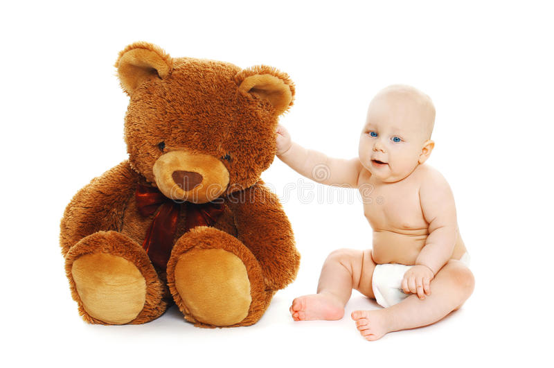 Cute baby sitting with big teddy bear on white. Background stock photography