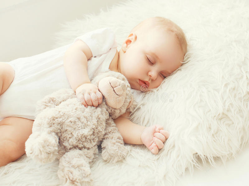 Cute Baby Sleeping On Soft Bed Home Stock Photo