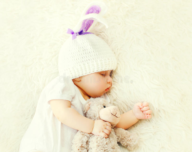 Cute baby sleeping on white bed at home close up stock photos
