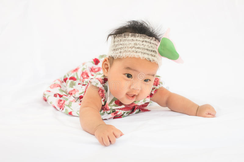 Cute baby smiling girl with rose headband royalty free stock images