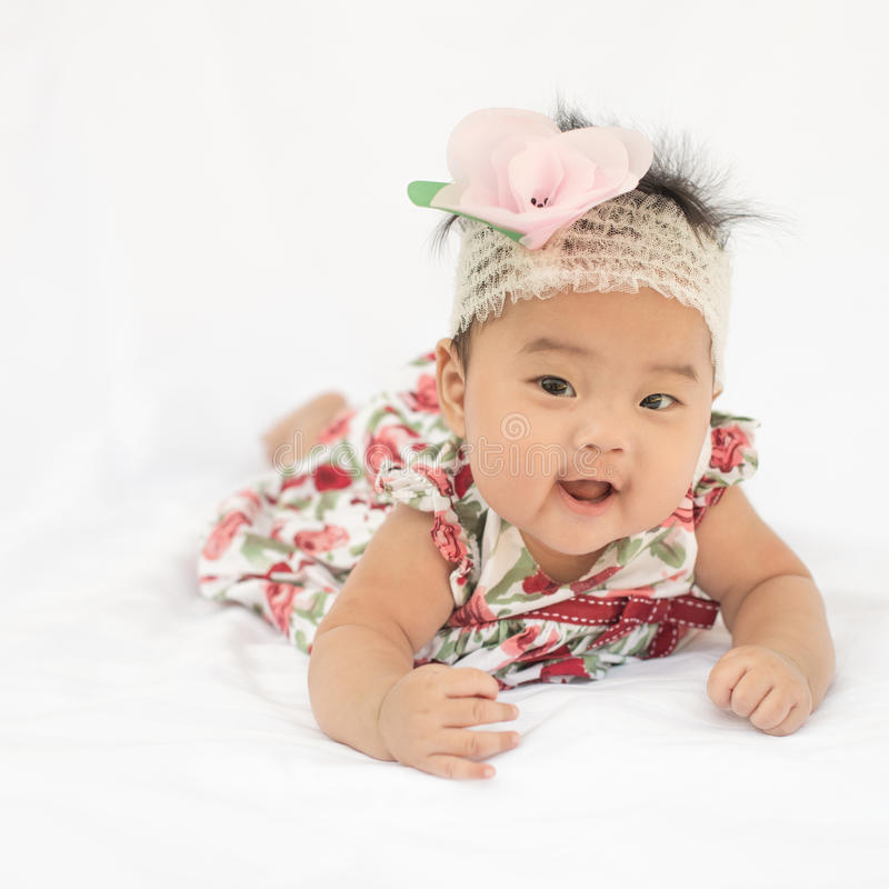 Cute baby smiling girl with rose headband royalty free stock photos