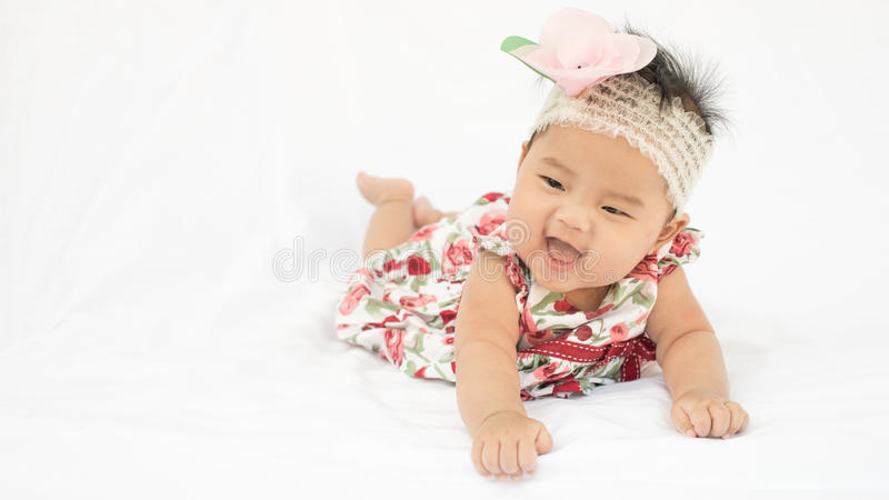 Cute baby smiling girl with rose headband stock photos
