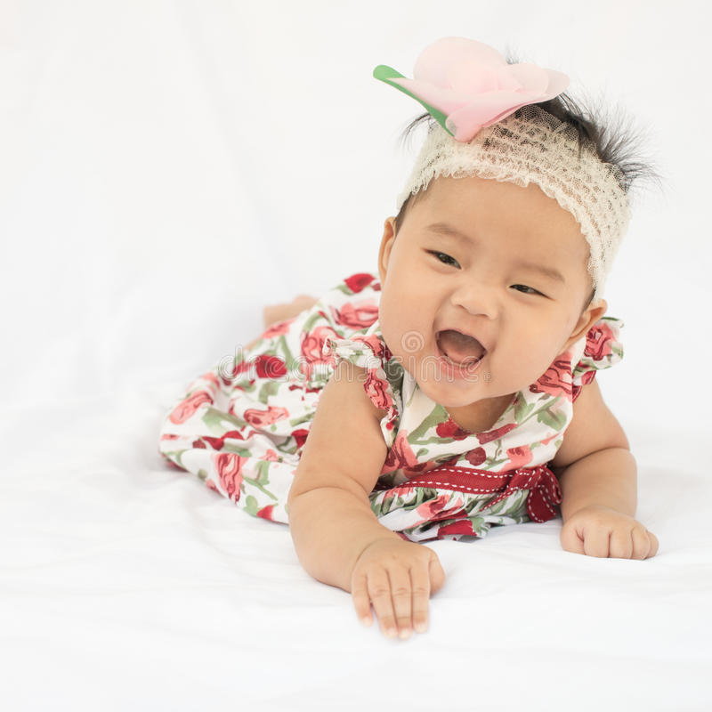 Cute baby smiling girl with rose headband stock image