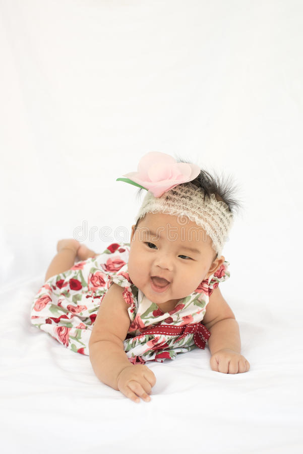 Cute baby smiling girl with rose headband royalty free stock photography