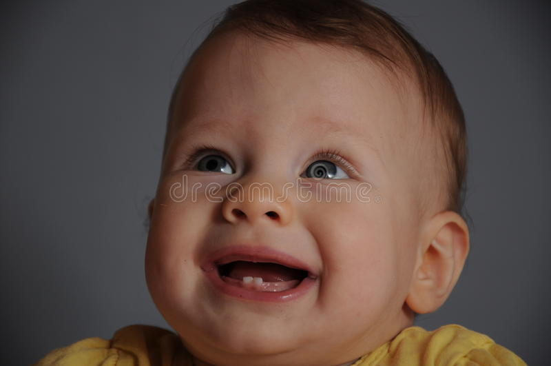 Cute baby with 2 teeth stock image