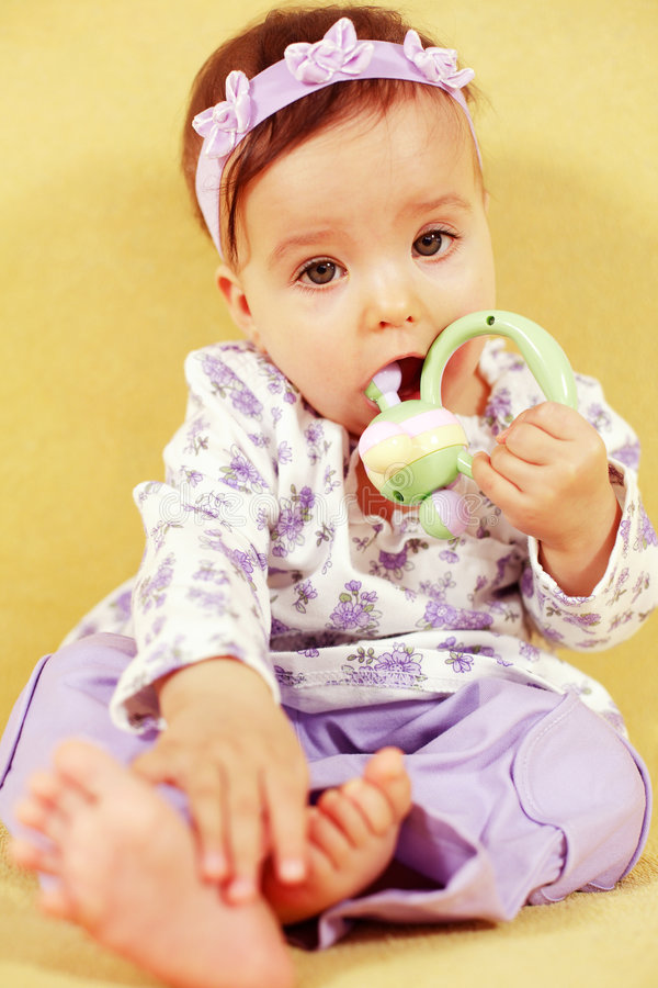 Cute baby with toy stock photography