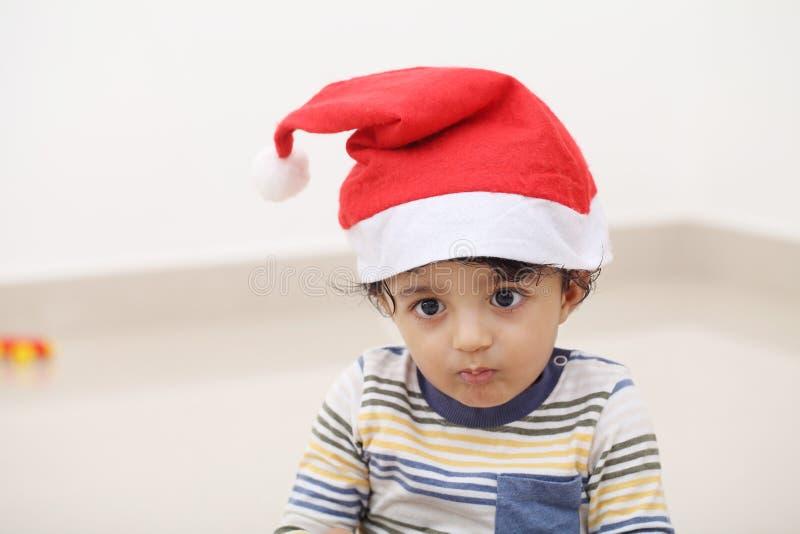 Cute baby wearing Santa hat royalty free stock photos