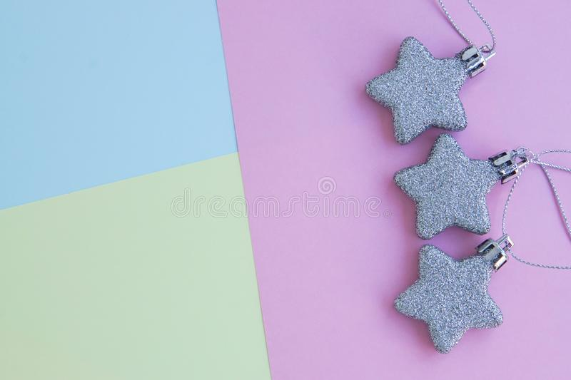 Cute background of glitter star on pastel sheet. Cute background of glitter star on pink blue yellow color pastel sheet stock images
