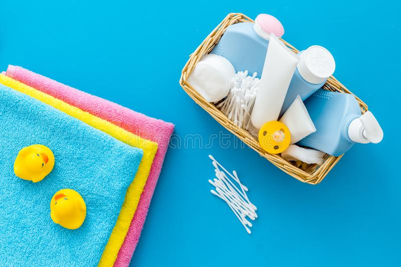 Cute bathroom cosmetics set with yellow rubber duck on blue background top view pattern. Cute bathroom cosmetics set with yellow rubber duck on blue background royalty free stock image