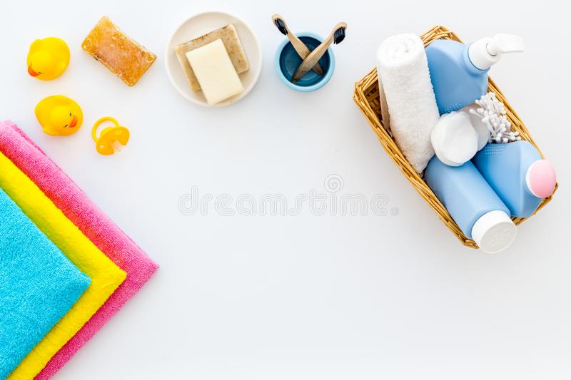 Cute bathroom cosmetics set with yellow rubber duck on white background top view pattern copy space frame. Cute bathroom cosmetics set with yellow rubber duck on royalty free stock image
