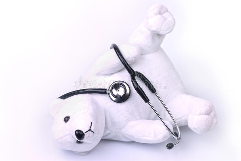 Cute bear. An adorable white teddy bear , holding a stethoscope royalty free stock images
