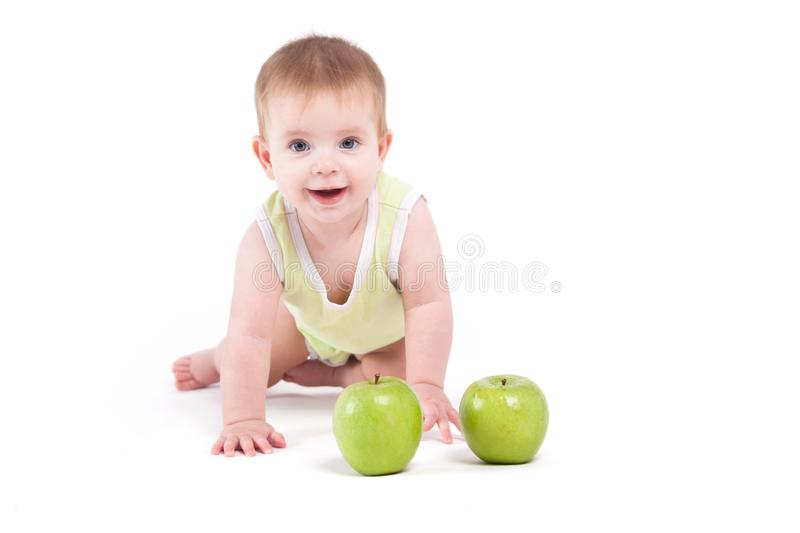 Cute beautiful baby boy in green shirt stand on all fours near g royalty free stock photos