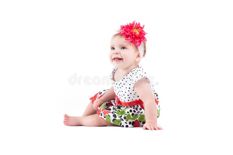 Cute beautiful baby girl in dot dress with butterflies and red w stock images