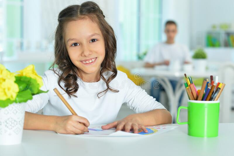 Portrait of a cute smiling girl drawing stock photos