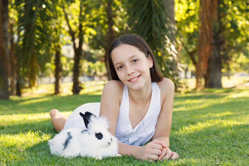 Cute Beautiful Smiling Teen Girl With White And Black Baby