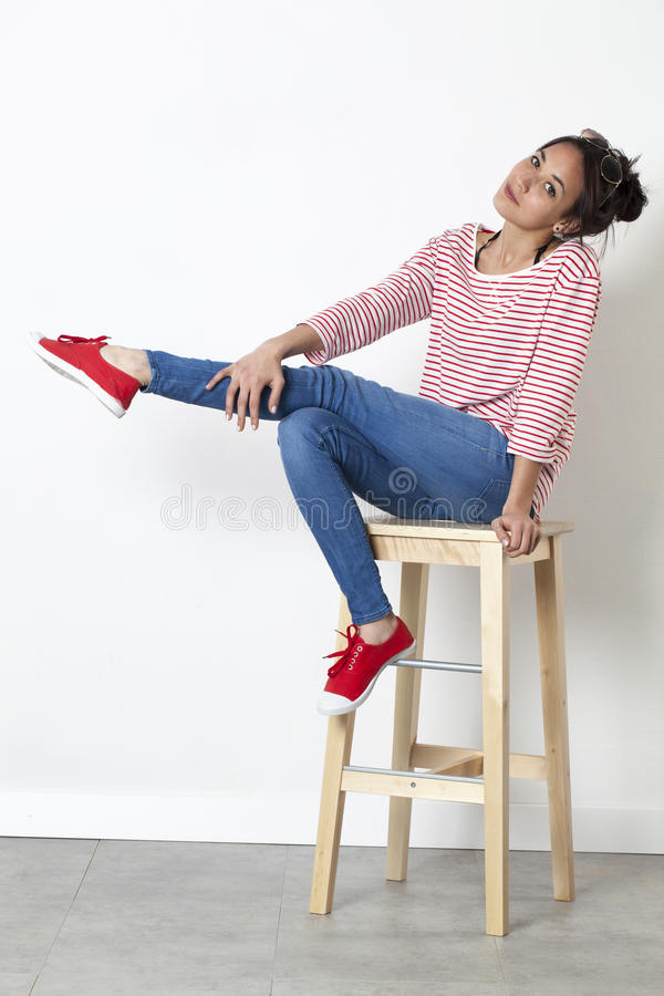 Cute beautiful young woman with attitude stretching one leg stock photos