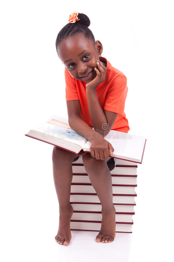 Cute black african american little girl reading a book - African stock images