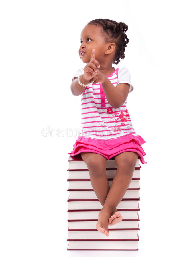 Download Cute Black African American Little Girl Seated In A Stack Of Boo Stock Photo - Image: 31066440