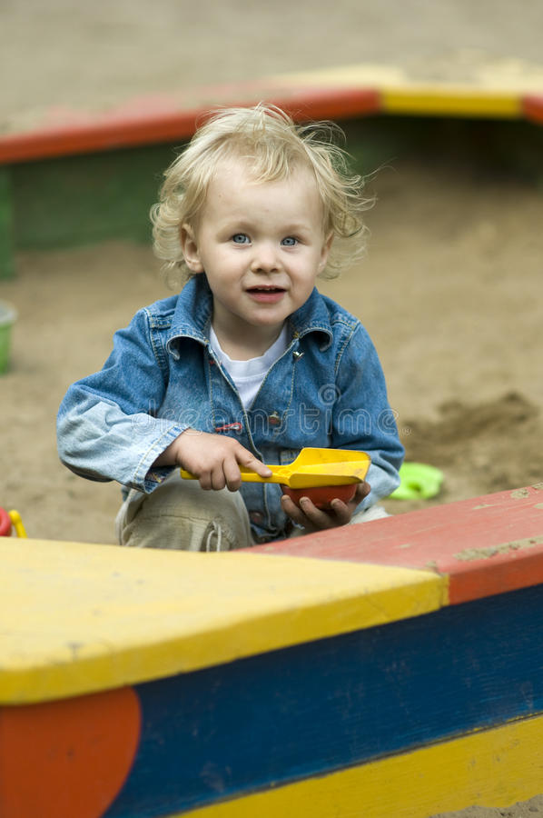 Download Cute Blond Child Playing In Sandbox Stock Photo - Image: 14323842