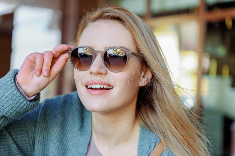 Cute blond girl expressing her interest royalty free stock photos
