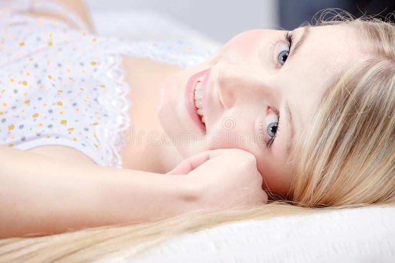Download Cute blond girl on pillow stock photo. Image of woman - 22920826
