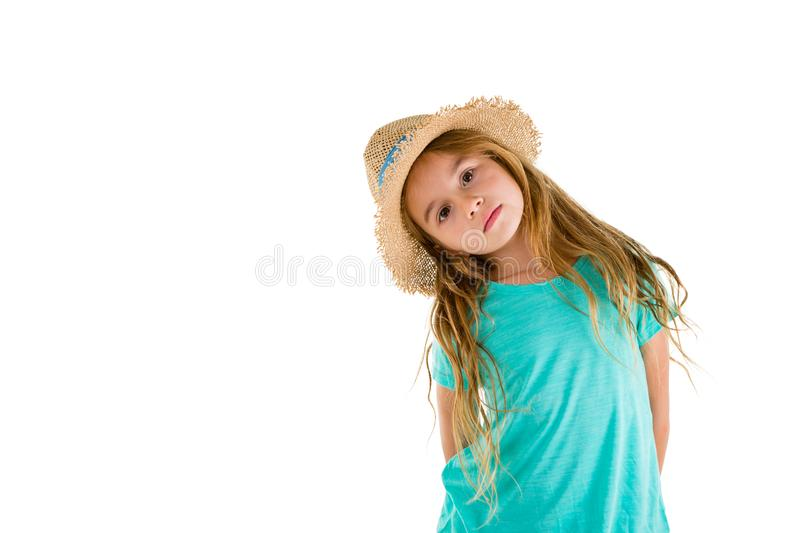 Cute blond girl tilting her head to the side royalty free stock photo