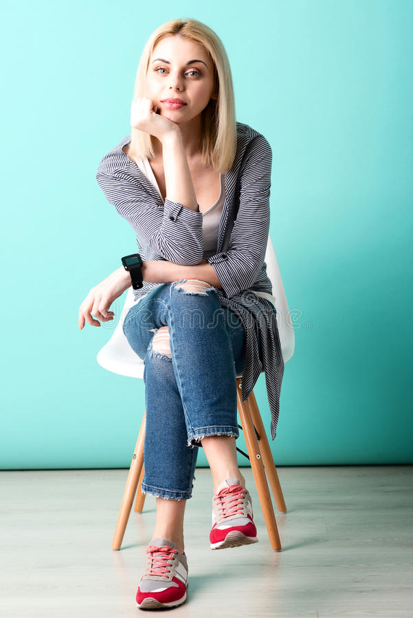 Cute blond girl is waiting for someone stock image