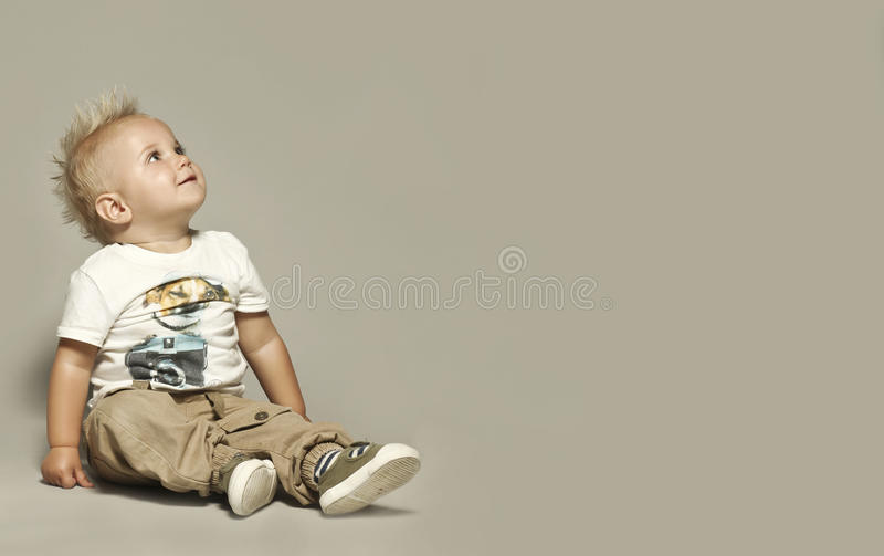 Cute blond kid looking up. Bigger background stock images