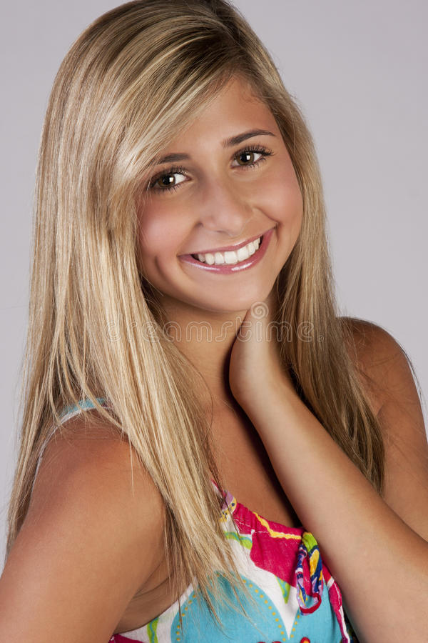 Cute blond teenage girl royalty free stock photography