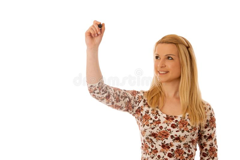 Cute blond woman writing on blank transparent board with a marker isolated over white background royalty free stock photo