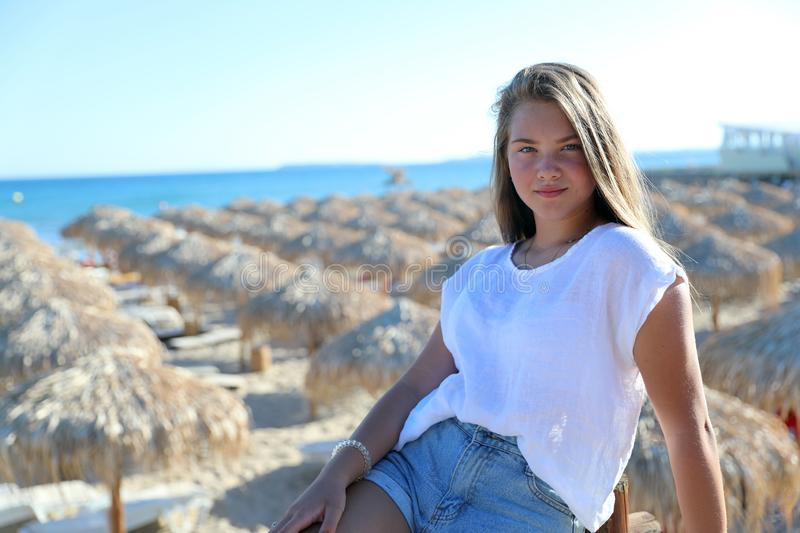Cute Blond Young Girl Posing For The Camera At The Beach stock image