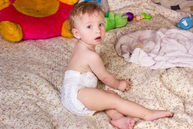 Cute blonde baby girl with beautiful blue eyes stock photos