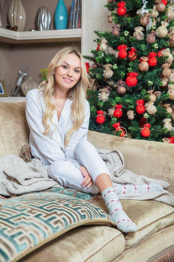 Cute blonde dressed in pajamas stock photos
