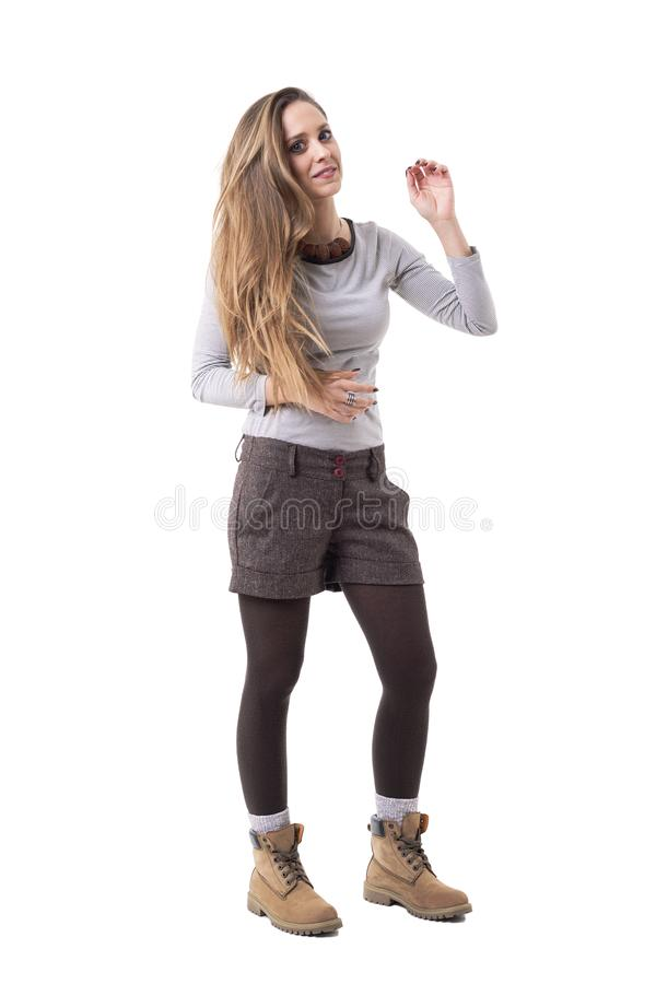 Cute blonde long haired young hipster woman in stylish second hand clothes. royalty free stock photo