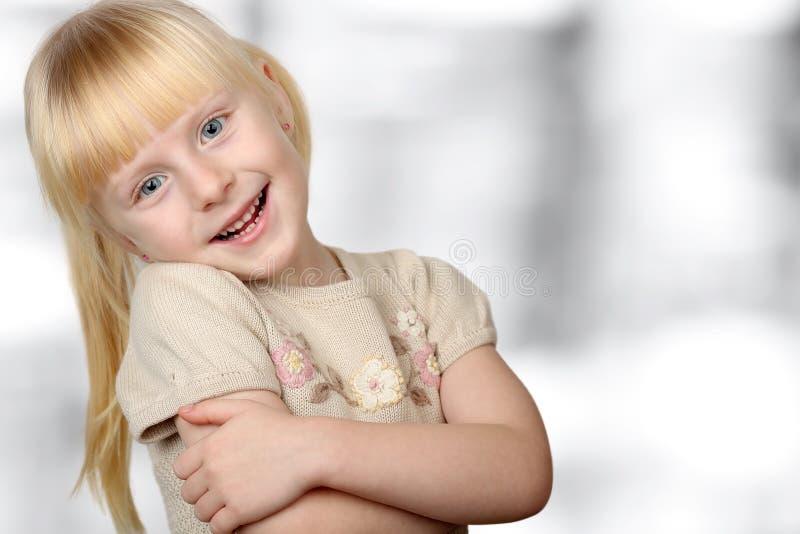 Cute blonde smiling girl royalty free stock image