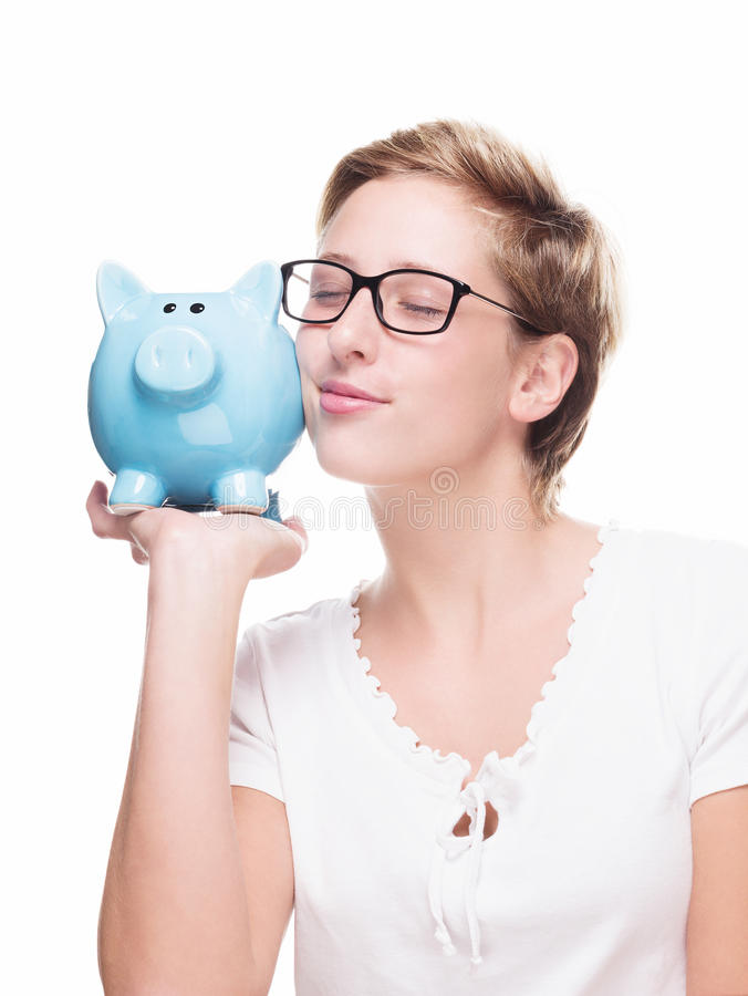 Cute blonde woman cuddling with a piggybank royalty free stock images