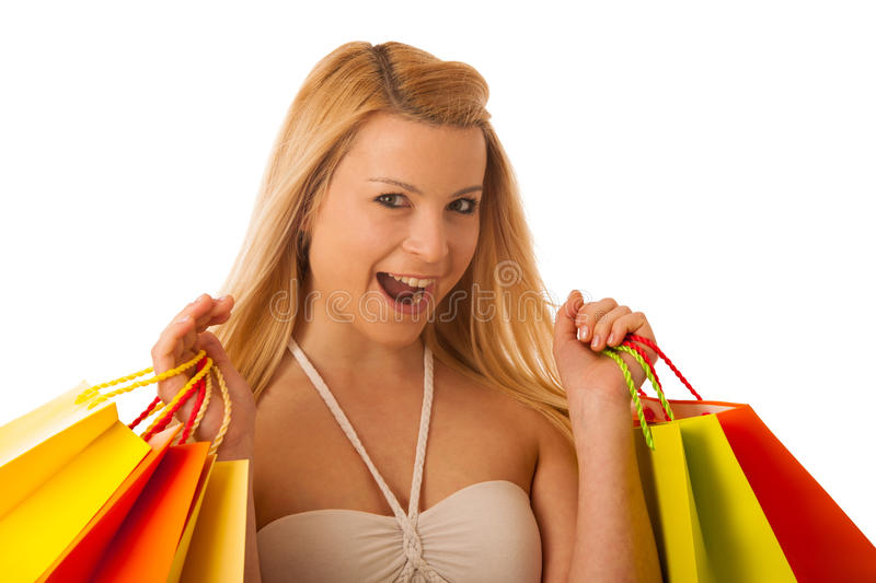 Cute blonde woman with shopping vibrant bags isolated over white stock images