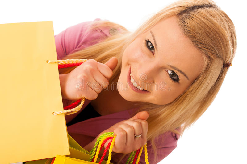Cute blonde woman with shopping vibrant bags isolated over white stock photos