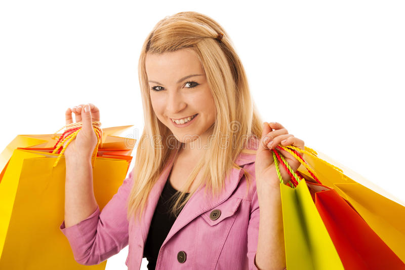 Cute blonde woman with shopping vibrant bags isolated over white royalty free stock photos