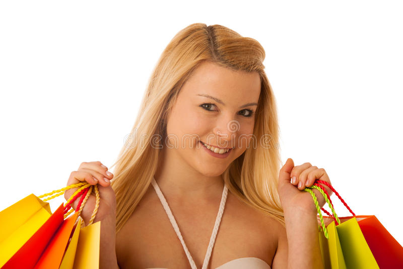 Cute blonde woman with shopping vibrant bags isolated over white stock image