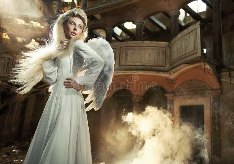 Cute blondie as an angel stock photos