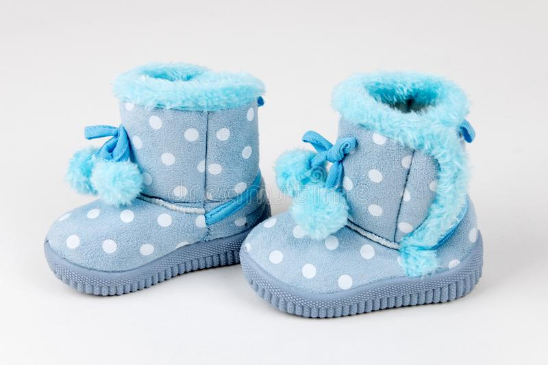 Cute blue baby shoes royalty free stock photography