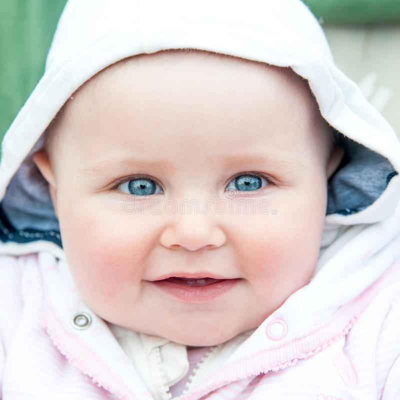 Cute blue-eyed baby royalty free stock image