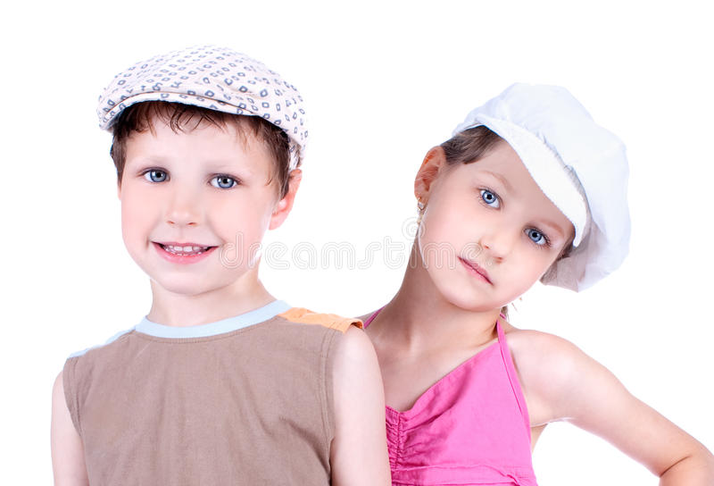 Cute blue-eyed children with whit caps. Posing, close up royalty free stock images